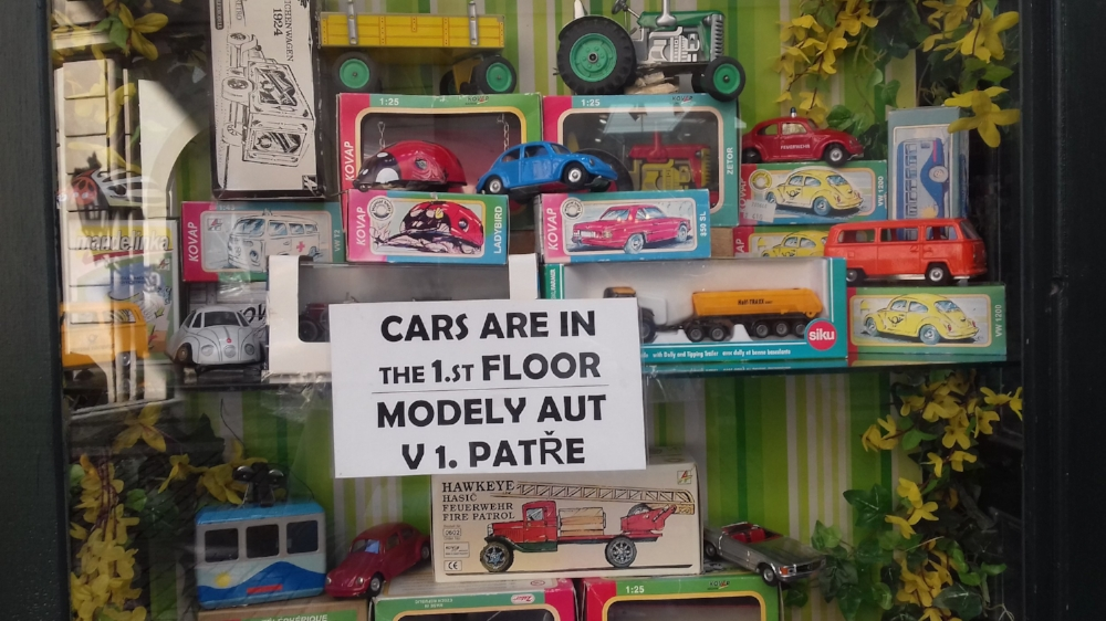 My correction: Cars are on the 2nd floor (US) / Cars are on the 1st floor (UK)  As a language learner myself I know that prepositions are the hardest thing to get right in another language.