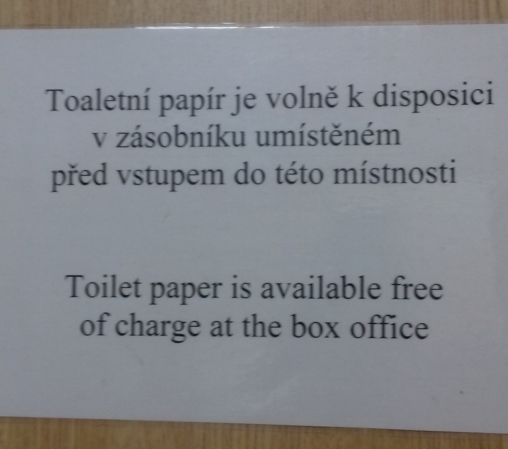 My translation: Toilet paper is available from the entrance  This sign is from a public toilet (not a theatre - tickets are not being sold to watch people use the facilities). There's a small cabin at the entrance where you pay and take some toilet paper.