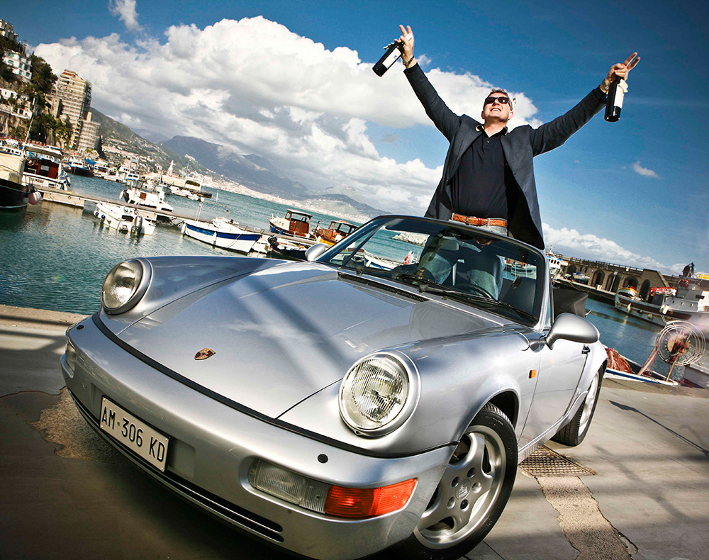 Porsche driver with wine.jpg