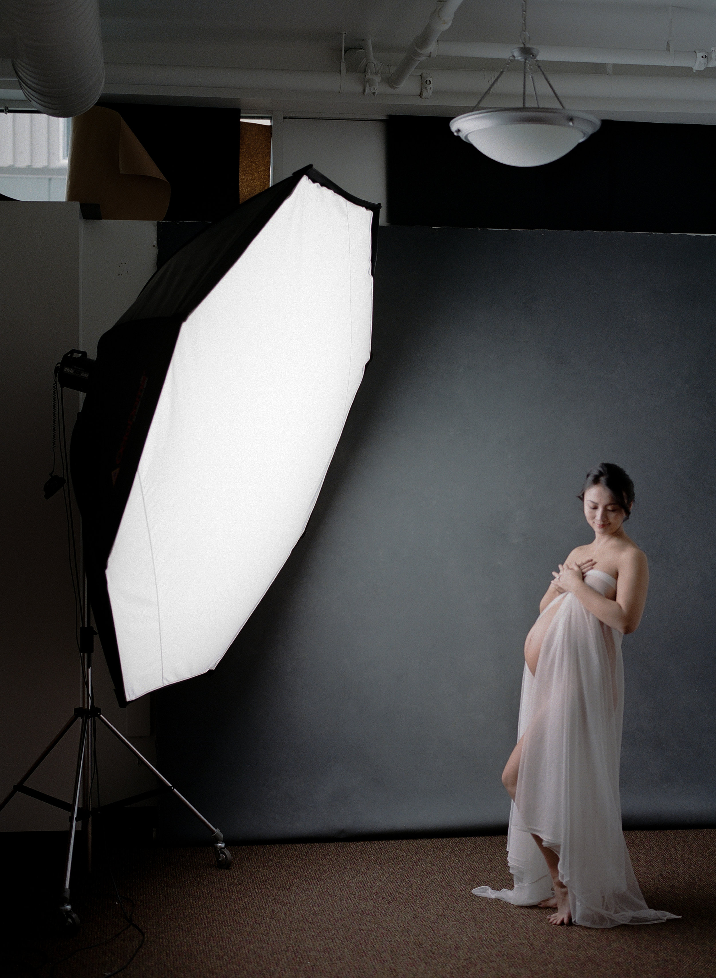 Behind the scenes photo of the simple, one light studio lighting set up that helped me build a six figure photography business