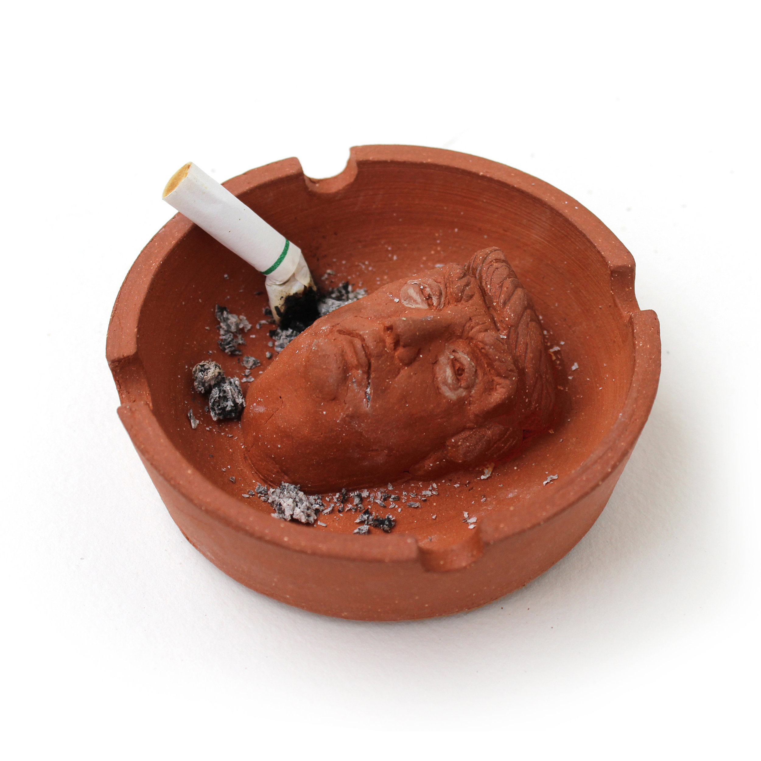 "+++ CURRENTLY OUT OF STOCK +++ RESTOCKING SHORTLY FOR THE HOLIDAYS! HANG TIGHT!! CHECK BACK!! +++   Wheel thrown terra-cotta ashtray with press-molded (butt)head. Approximately 3.75"" diameter by 1.25"" height"