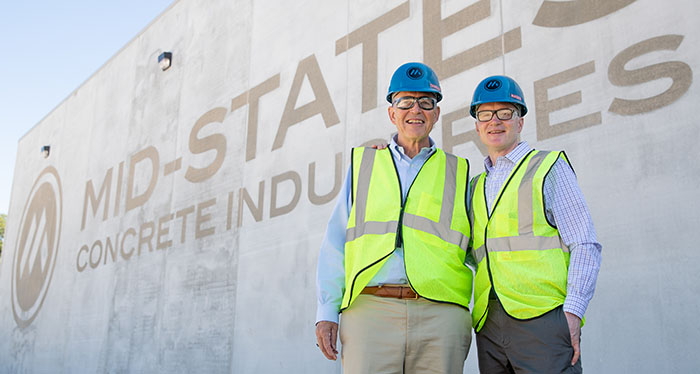 Mid-States Concrete CEO Charles Harker and President Hagen Harker outside our new water reclamation building.
