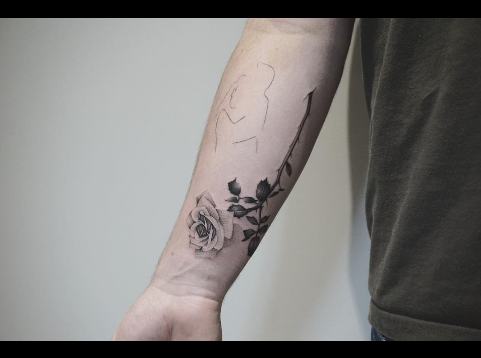 rose tattoo.png