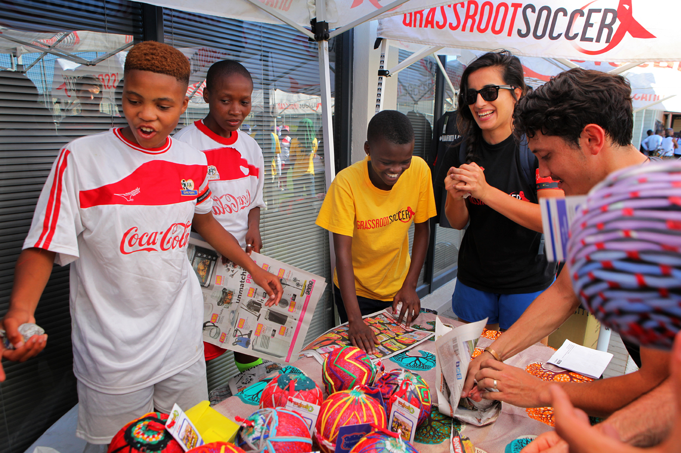 Senior RV players make and sell Ragballs at a FIVES Futbol-Grassroot Soccer World AIDS Day festival