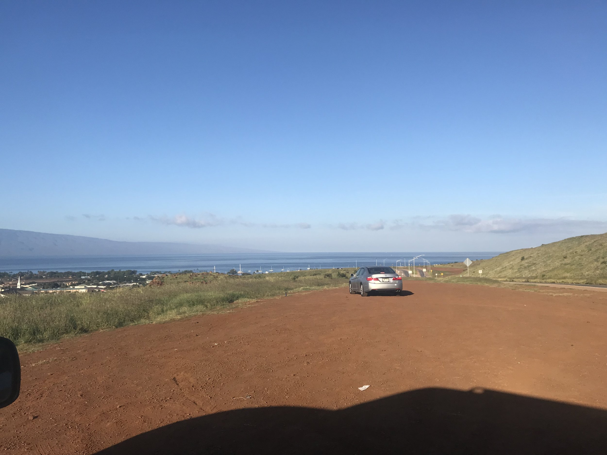 The Lahaina Bypass--safe enough from a tsunami. Oahu is about 80 miles from where I stood, in the middle of the horizon.