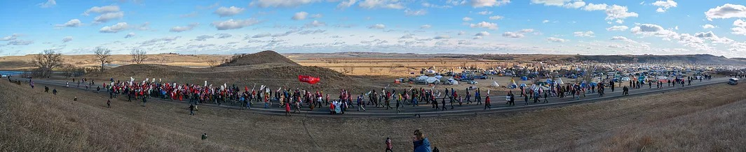 Water protectors marching towards an action