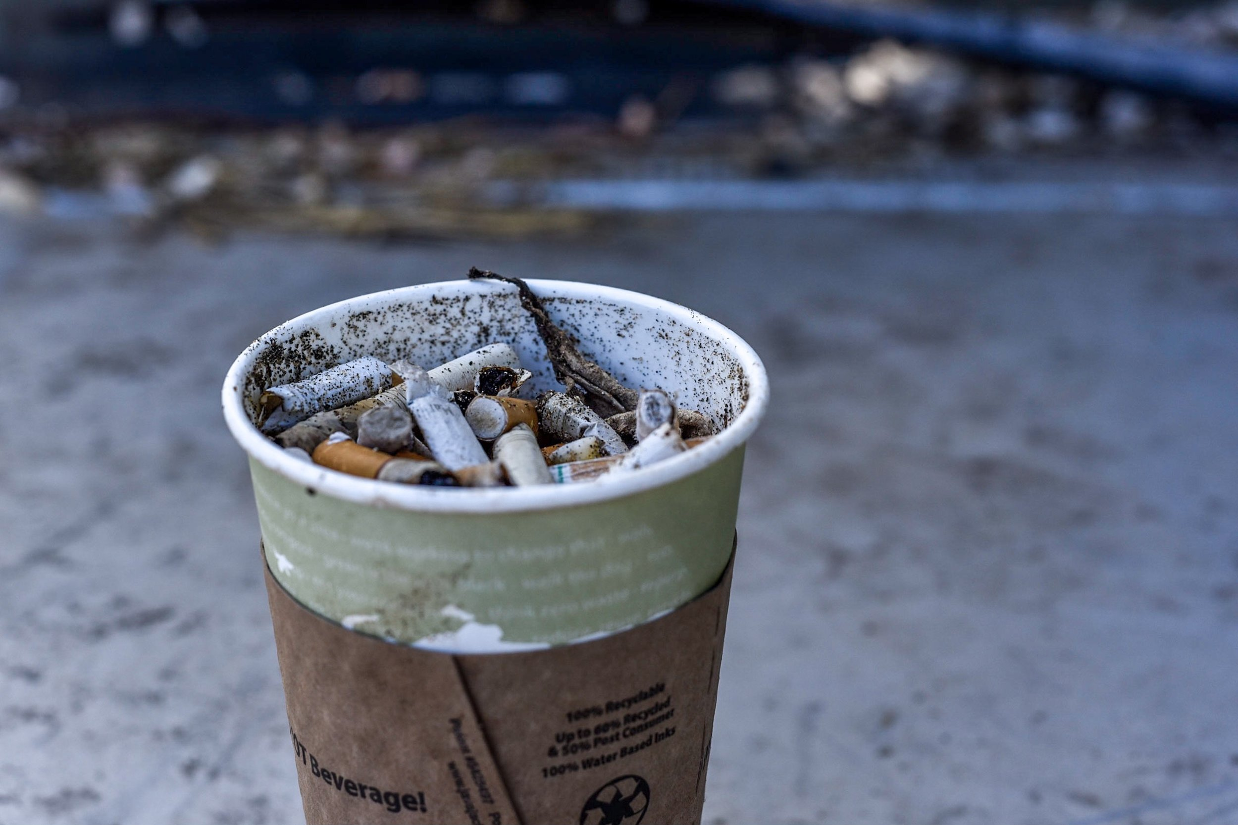 A full cup of cigarette butts retrieved from a morning's walk