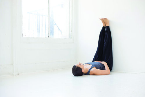 3. Viparita Karani (legs up the wall) featuring Farbrook Studio organic and ethical yoga clothes.