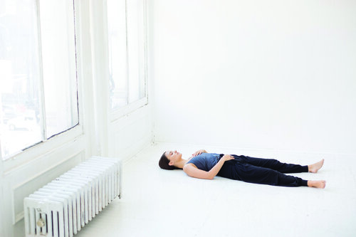 8. Savasana (corpse pose) featuring Farbrook Studio organic and ethical yoga clothes.