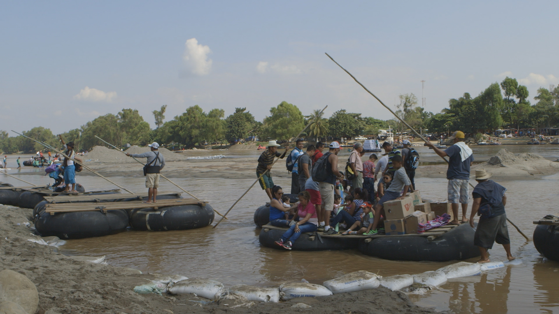 Migrants crossing the river