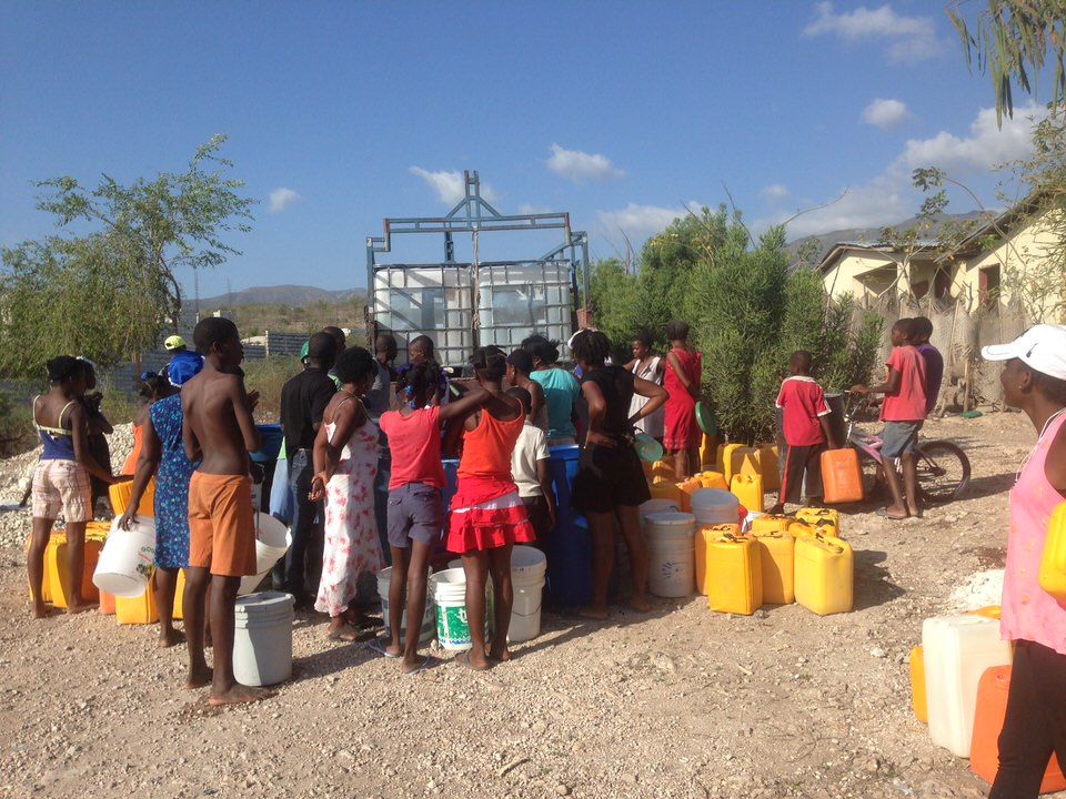 Haiti families receiving their water filters