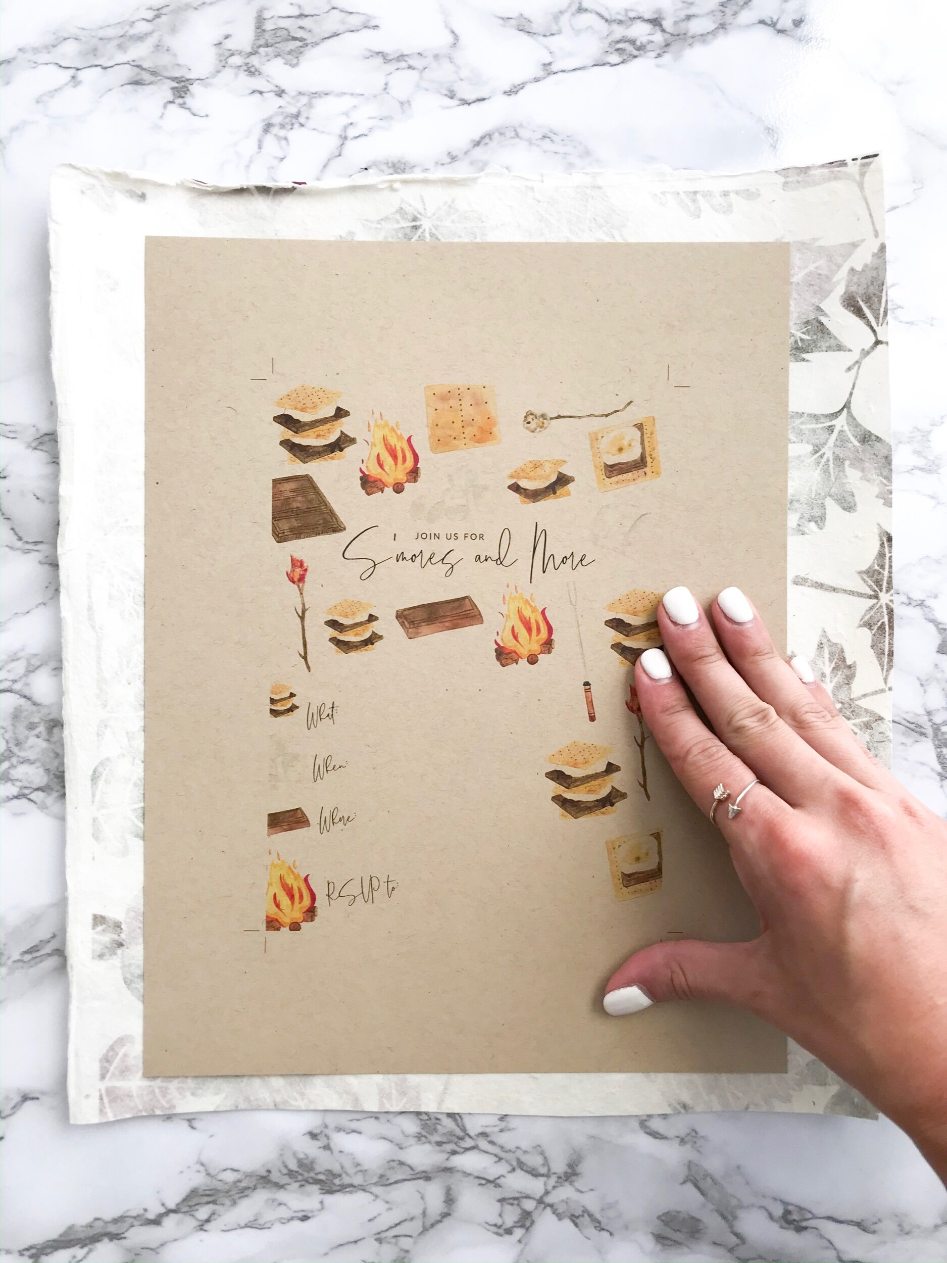 Step Three:  Press the untrimmed invitation on the sprayed scrapbook paper.