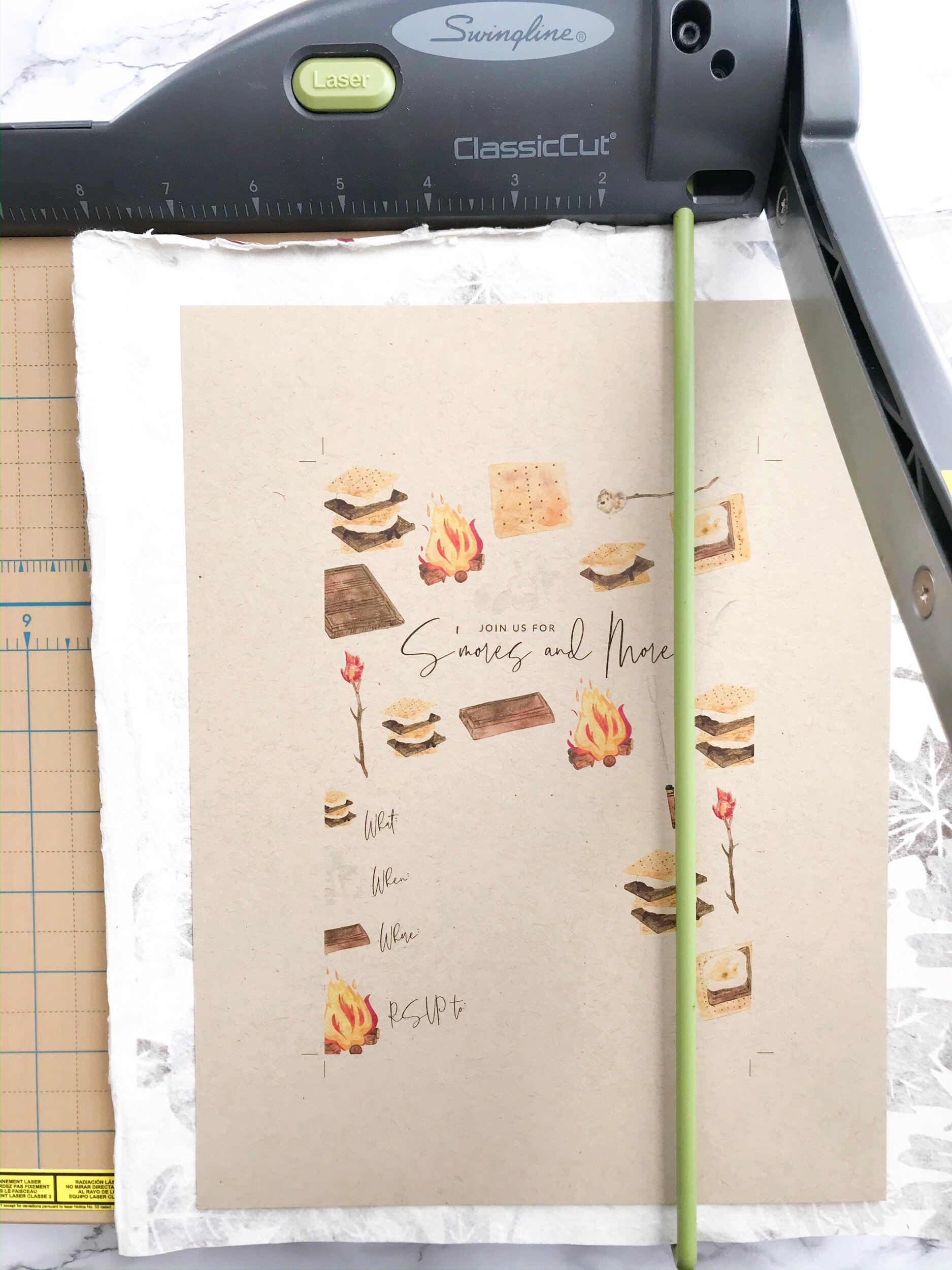 Step Four:  Trim your invitation with the adhered paper all at the same time to ensure the most even cuts!