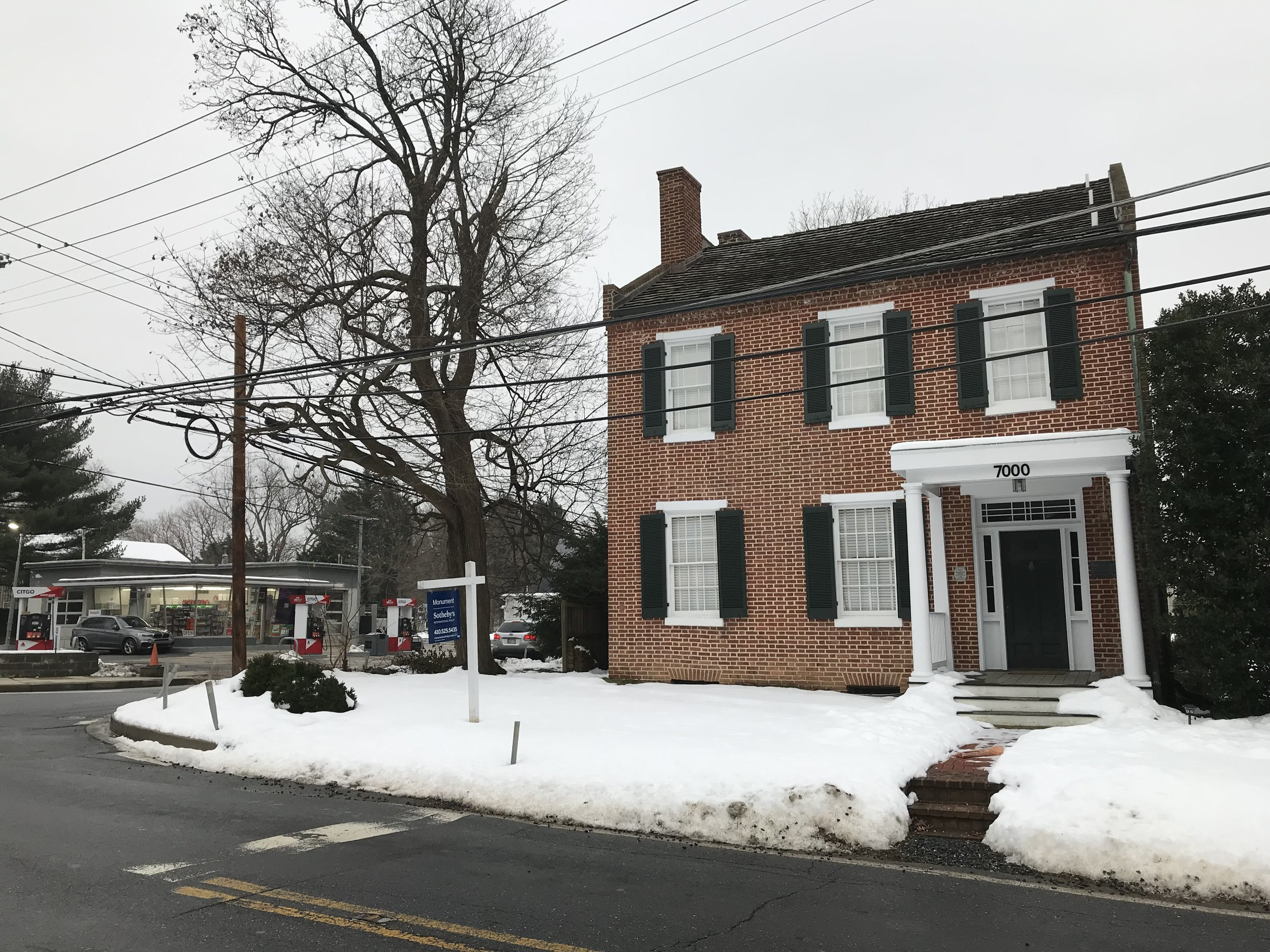 Front of the Revolutionary War-era house, now across the street from a modern gas station.