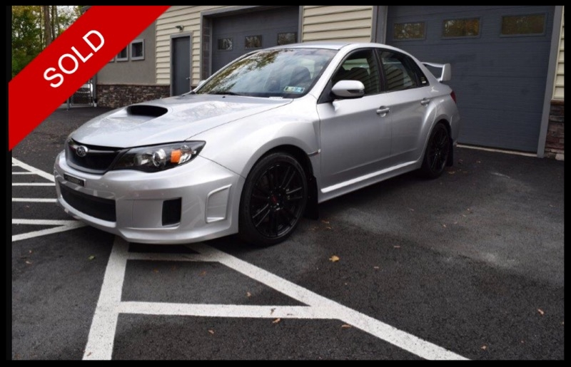 SOLD - Make: SubaruModel: WRX STiMileage: 43,800 miExterior Color: Spark Silver MetallicInterior Color: BlackEngine: 2.5 LDrivetrain: All Wheel DriveVIN: JF1GV8J62BL511248