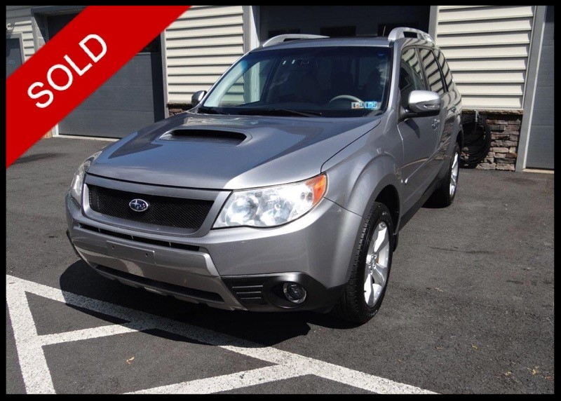 SOLD - 2011 Subaru Forester XT TouringSteel Silver Metallic on GreyVIN: JF2SHGHC7BH716988