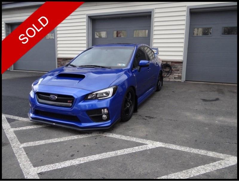 SOLD - 2015 Subaru WRX STi - LimitedWR Blue Pearl on BlackVIN: JF1VA2U69F9827020
