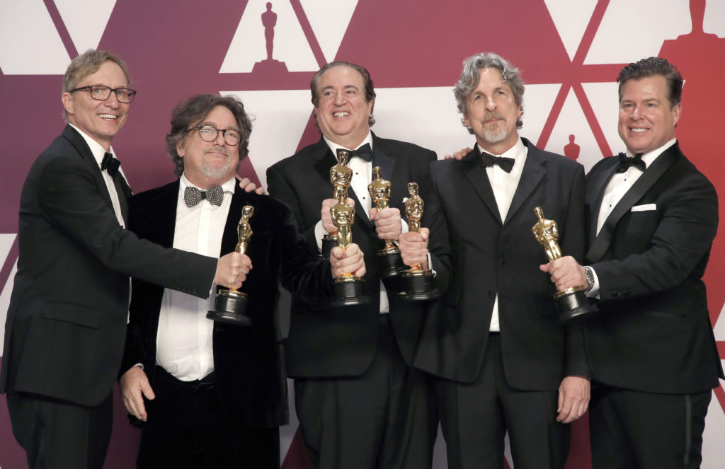 OLG Graduate and Hollywood producer Jim Burke ('72) is on the far left holding one of the Academy Awards for his film Green Book.