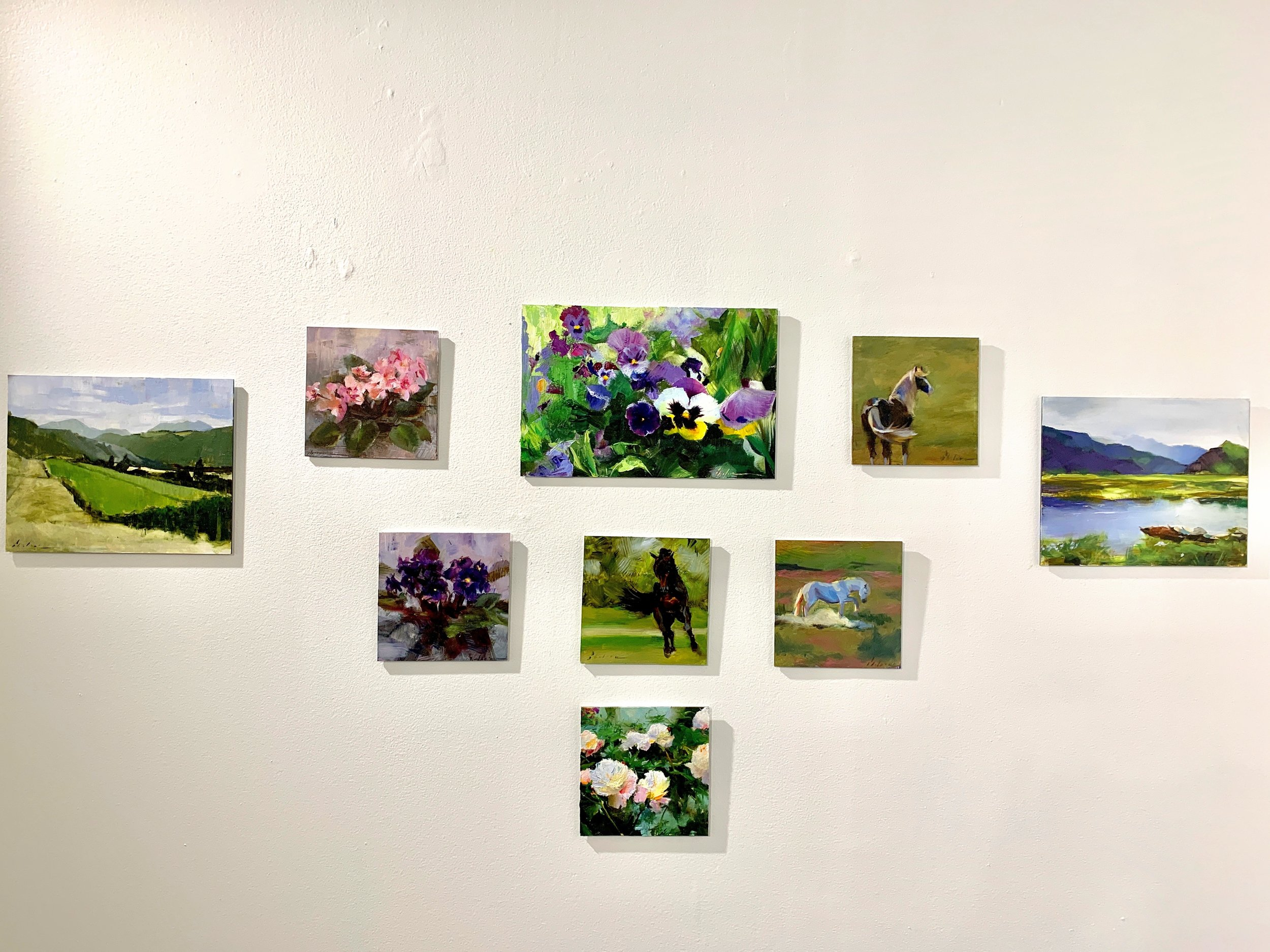 """""""April Pansies"""" up on the gallery wall before the opening"""