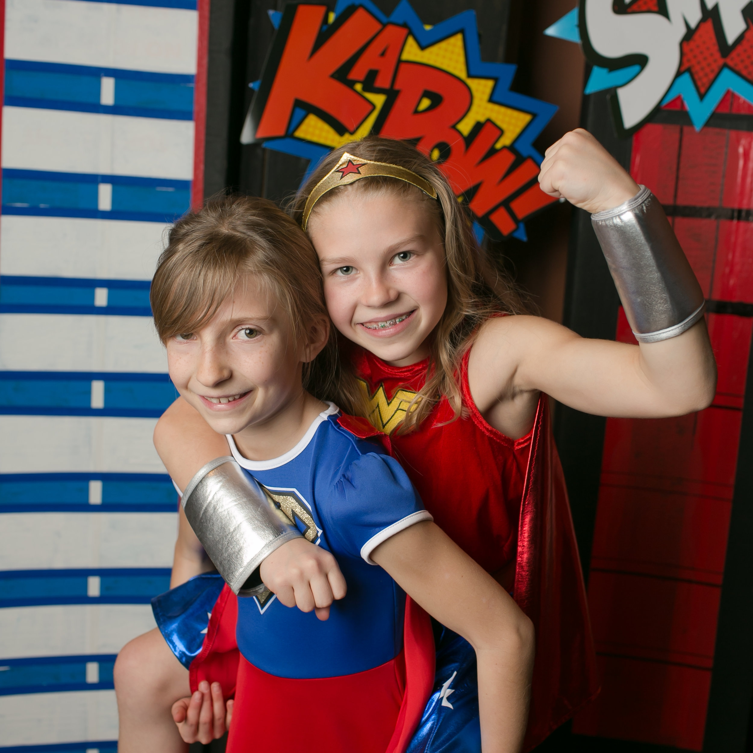 """Two students pose at the """"Marvel""""ous Community Night."""