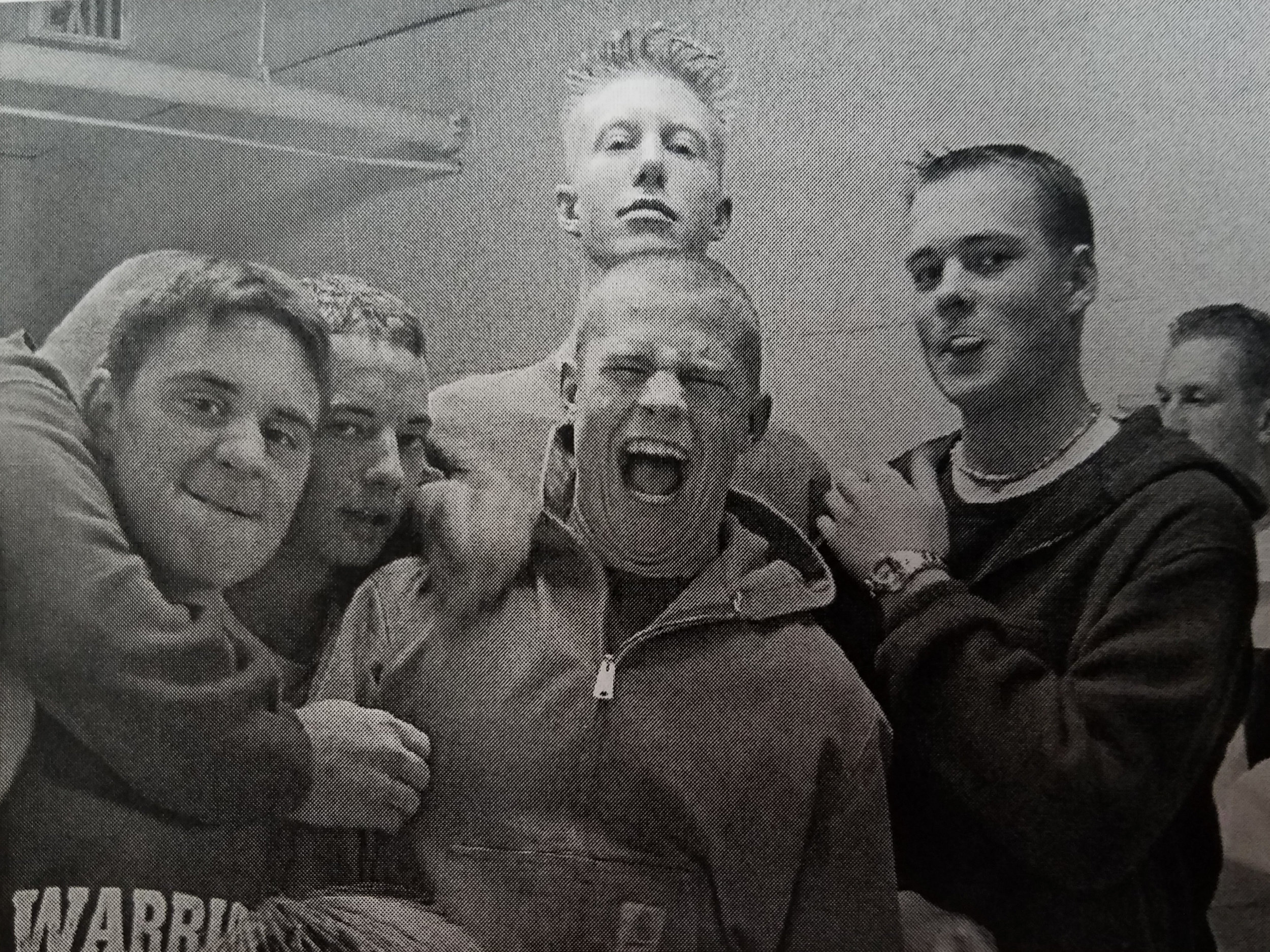 The Warriors basketball varsity team celebrates a win, ca. 2000
