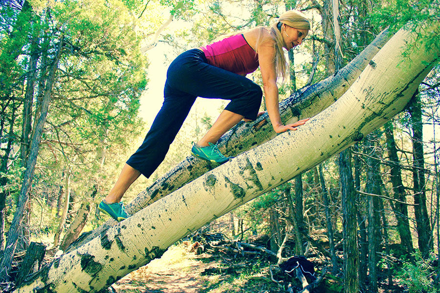 Woman climbing up tree.jpg