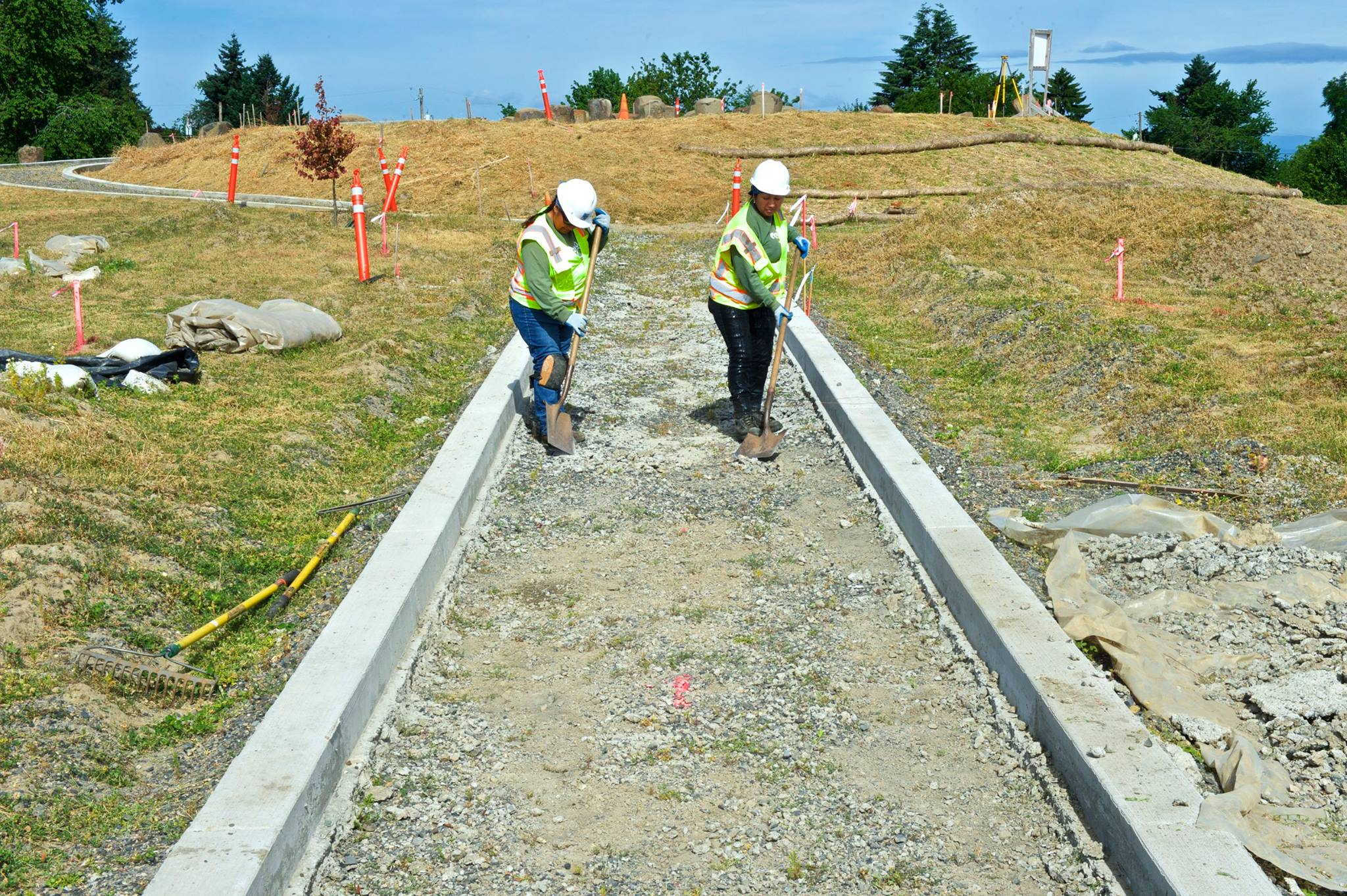 Crew members Rosa and Zoemy prepare a pathway at Cully Park.