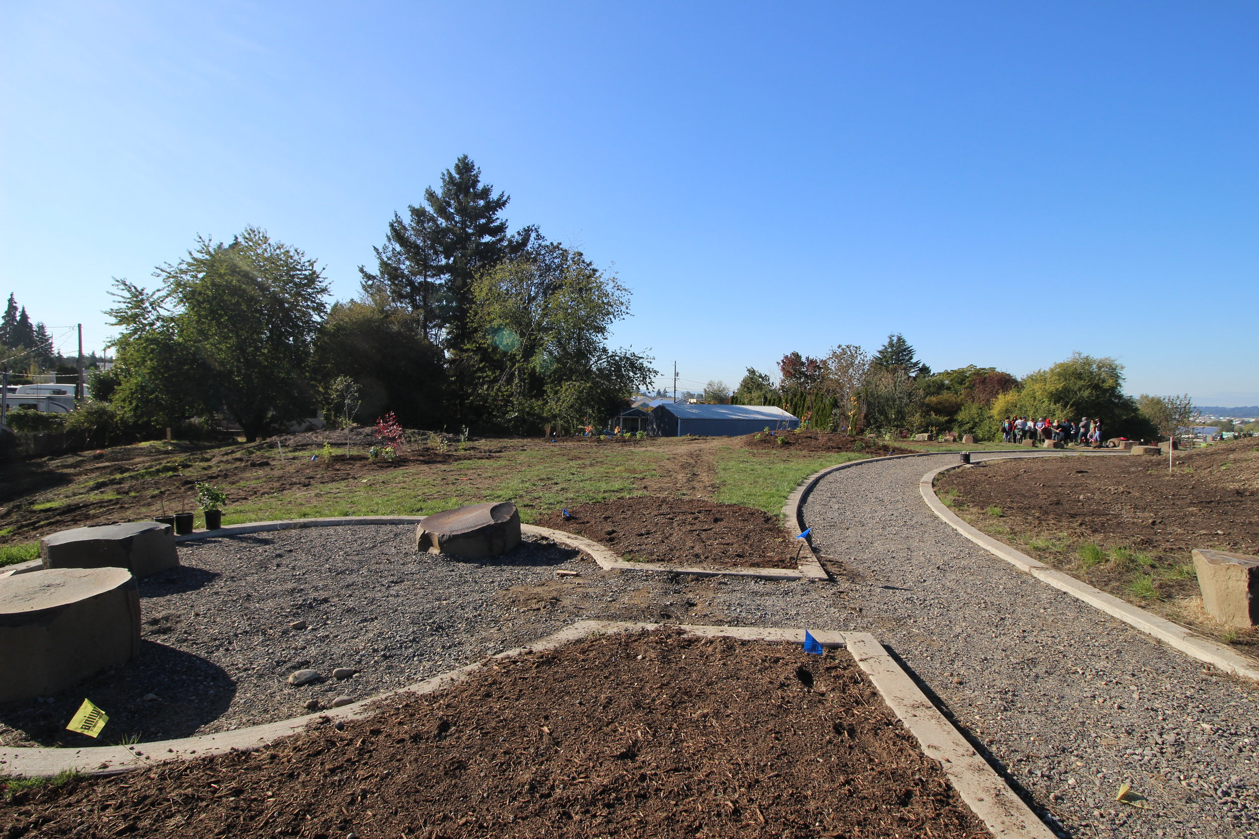 The Native Gathering Garden includes a food forest, designed with sitting areas to provide natural spaces for workshops and classes.