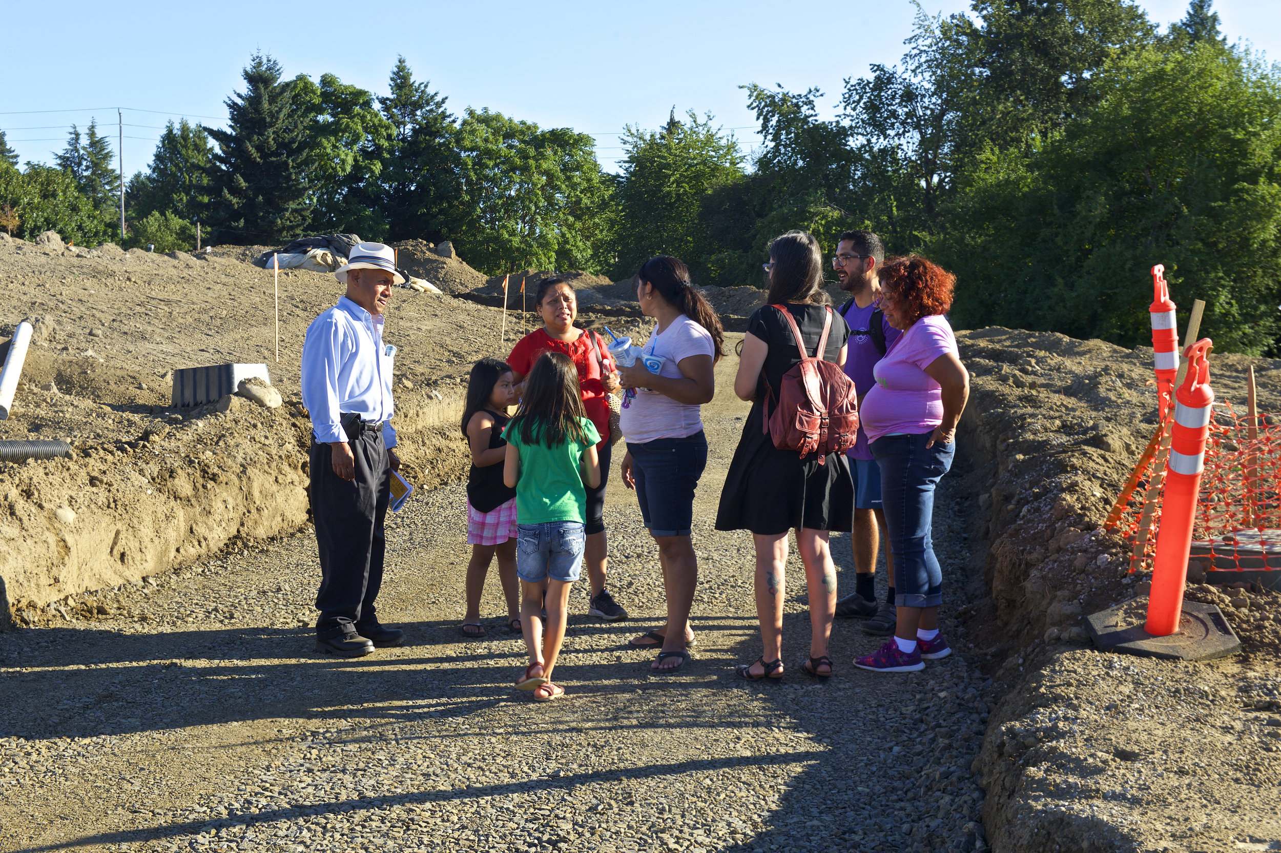 Verde staff member Pedro Moreno leads a community tour of Cully Park in the summer of 2017. Naim Hasan Photography.