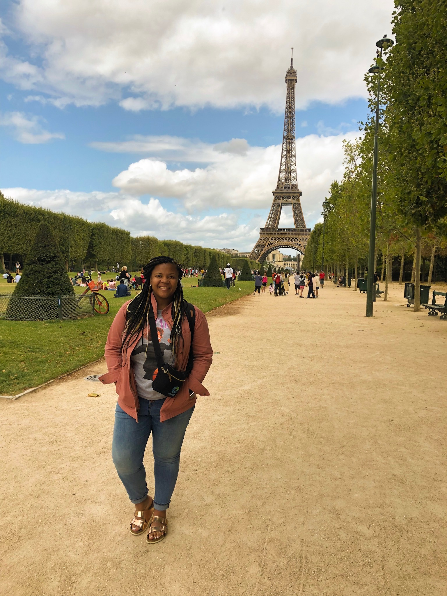 At the Eiffel Tower during my extended layover exploration!