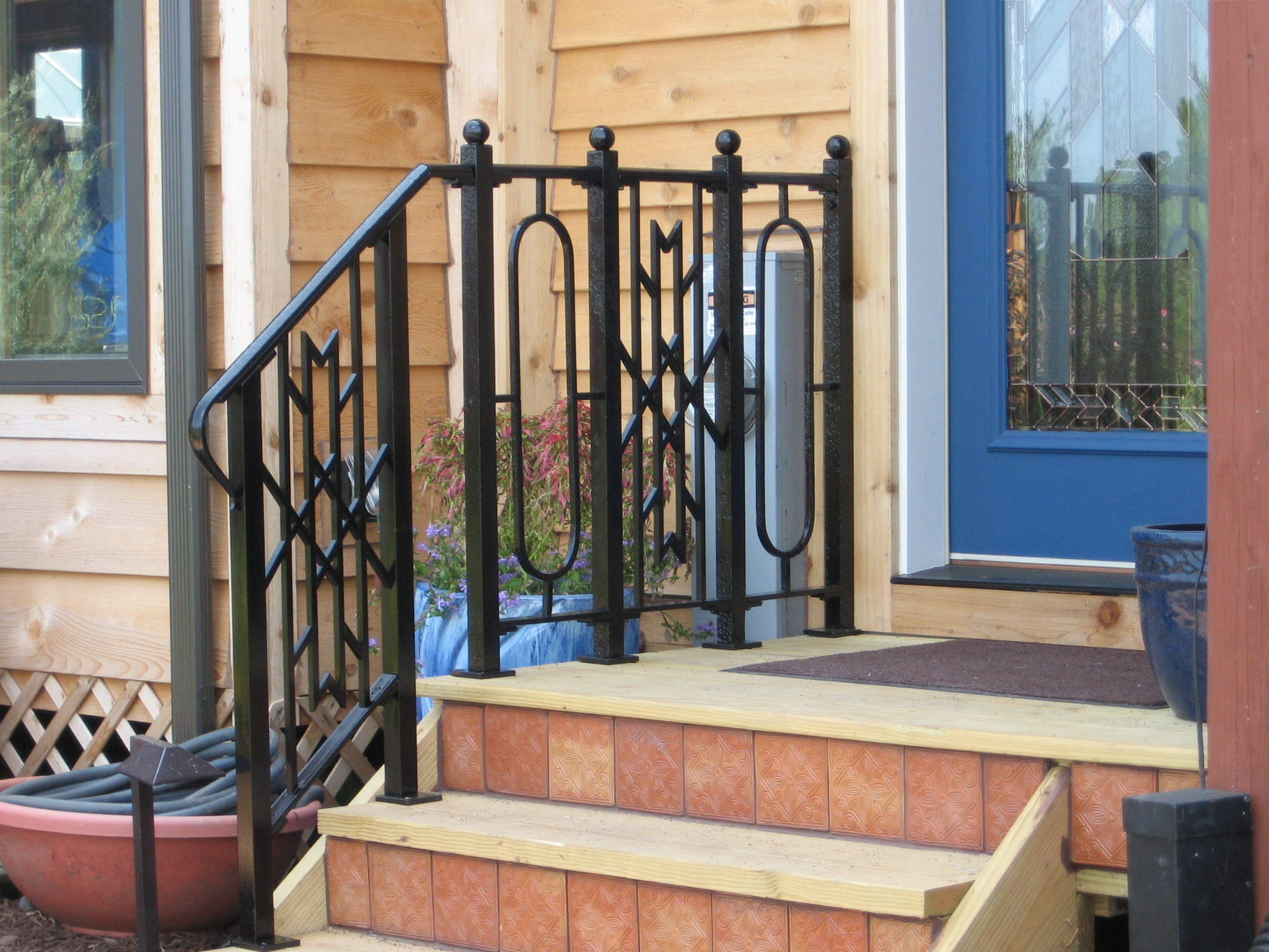 Railing designed from the beveled glass in door