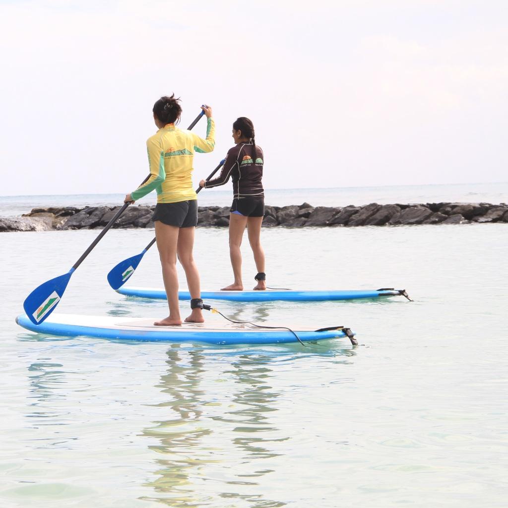 big-wave-dave-waikiki-stand-up-paddle-boarding-side.jpeg