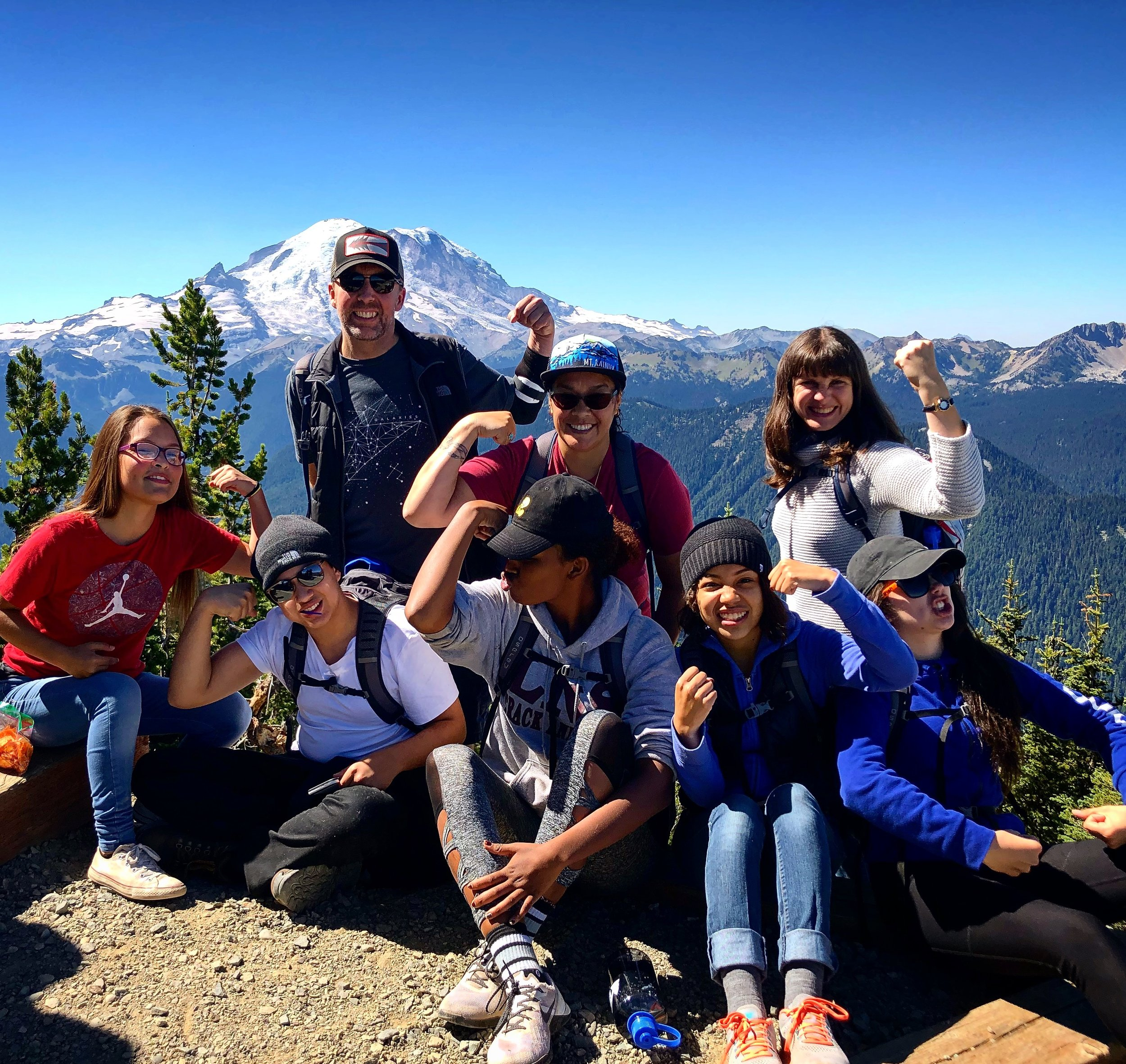 On the summit of Crystal Mountain overlooking Mt. Rainier. We are stronger together!