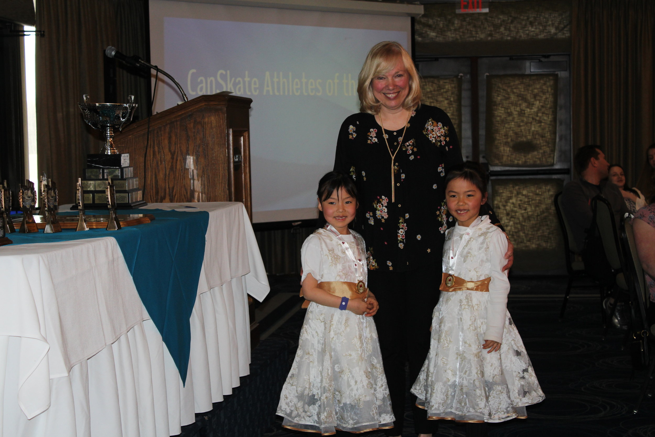 Jenny and Julie receiving their awards from GSC CanSkate Director, Sheilagh McCaskill