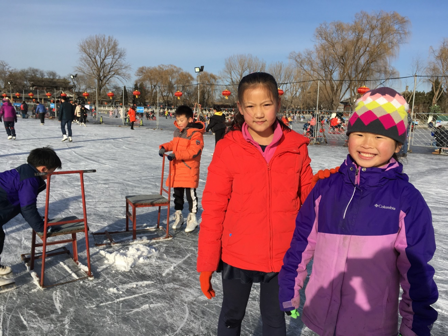 Marie and Jasper enjoying the afternoon making friends with other skaters at the lake.