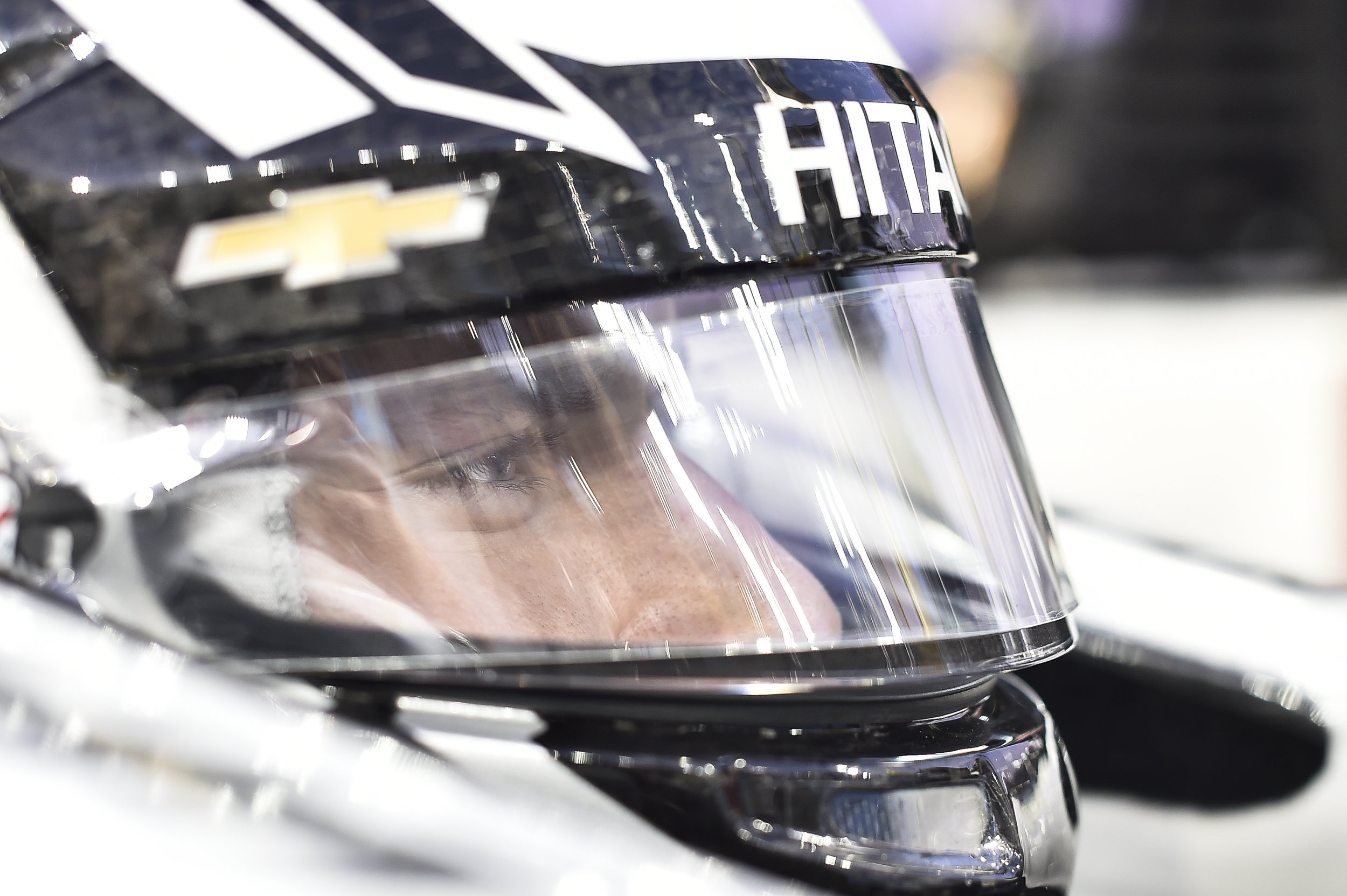 Newgarden waits on changes being made to his Chevrolet Indycar during testing.