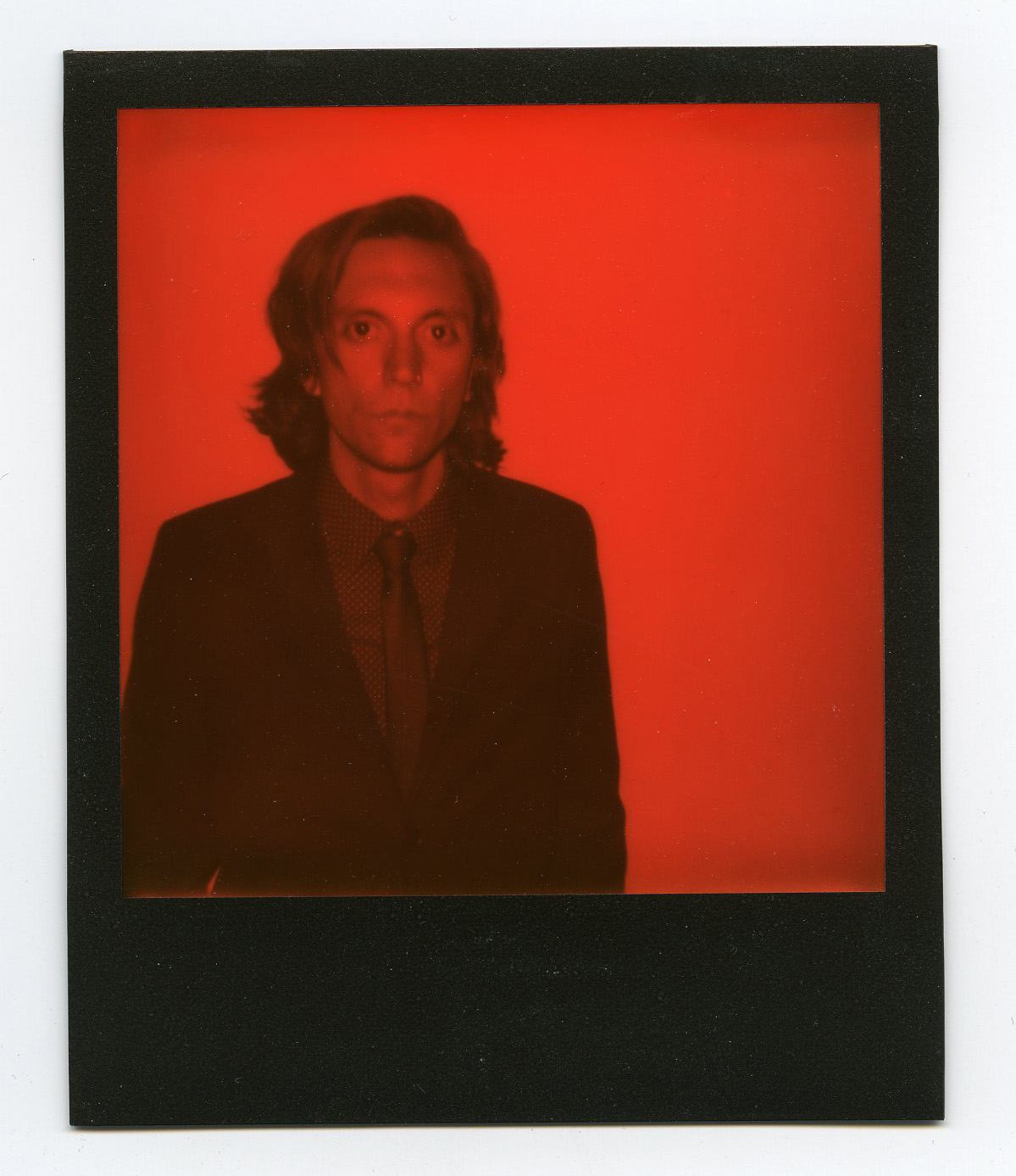 The tall cool one - Joe Skibinski - Shot on Polaroid 600 Camera with Impossible Black And Orange Duochrome Instant Film - Speedway, IN