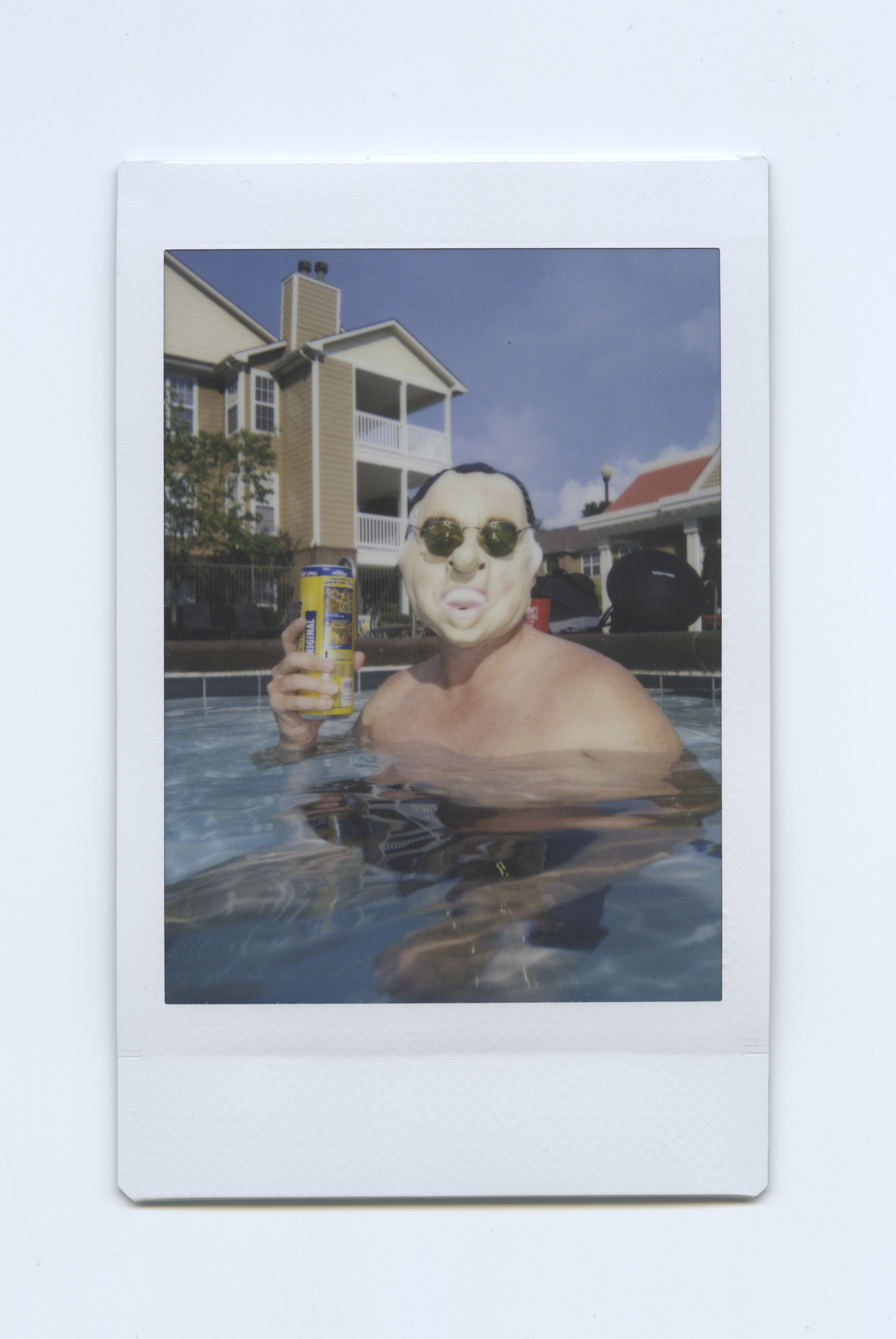 Tricky Dick at the pool. - Shot on Fujifilm Neo90 Camera with Fuji Instant Film - Indianapolis, IN