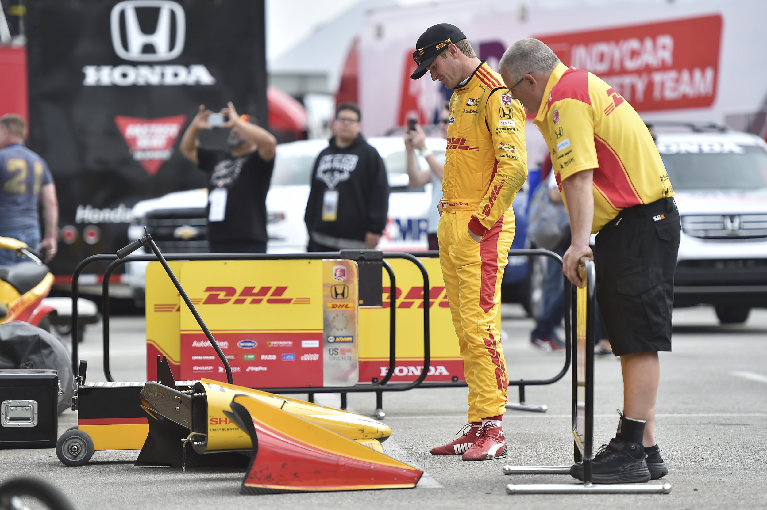 Ryan Hunter-Reay - Evaluates wing damage after the Long Beach Race