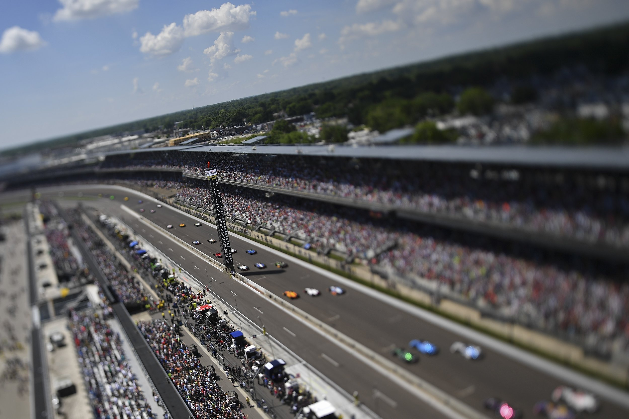 I wanted to do something different for the start of this year's Indy 500. Our staff has all bases covered, inside and outside turn 1,2,3 and 4. Why not the roof? The tilt-shift specialty lens gives a creative almost toy look to the shot.