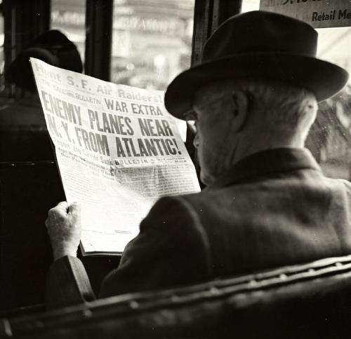 Man and Newspaper.jpg