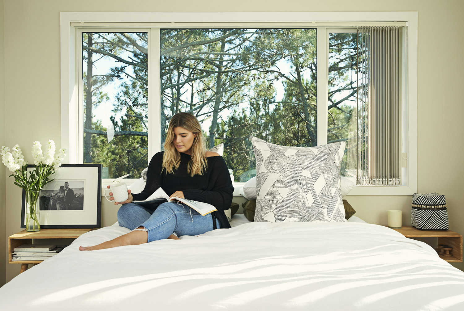 IVDM Photography_sealy campaign_commercial photography_mandy duncan sitting on bed.jpg