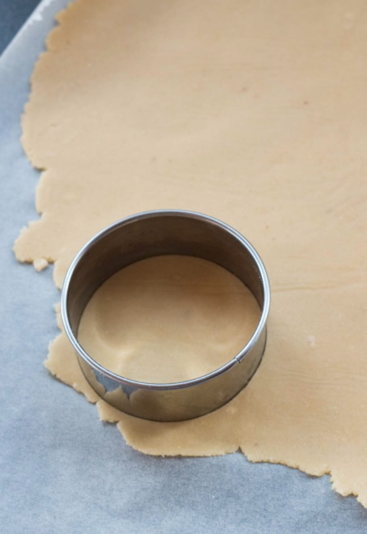 Roll out the dough and use cookie cutter to create circles.