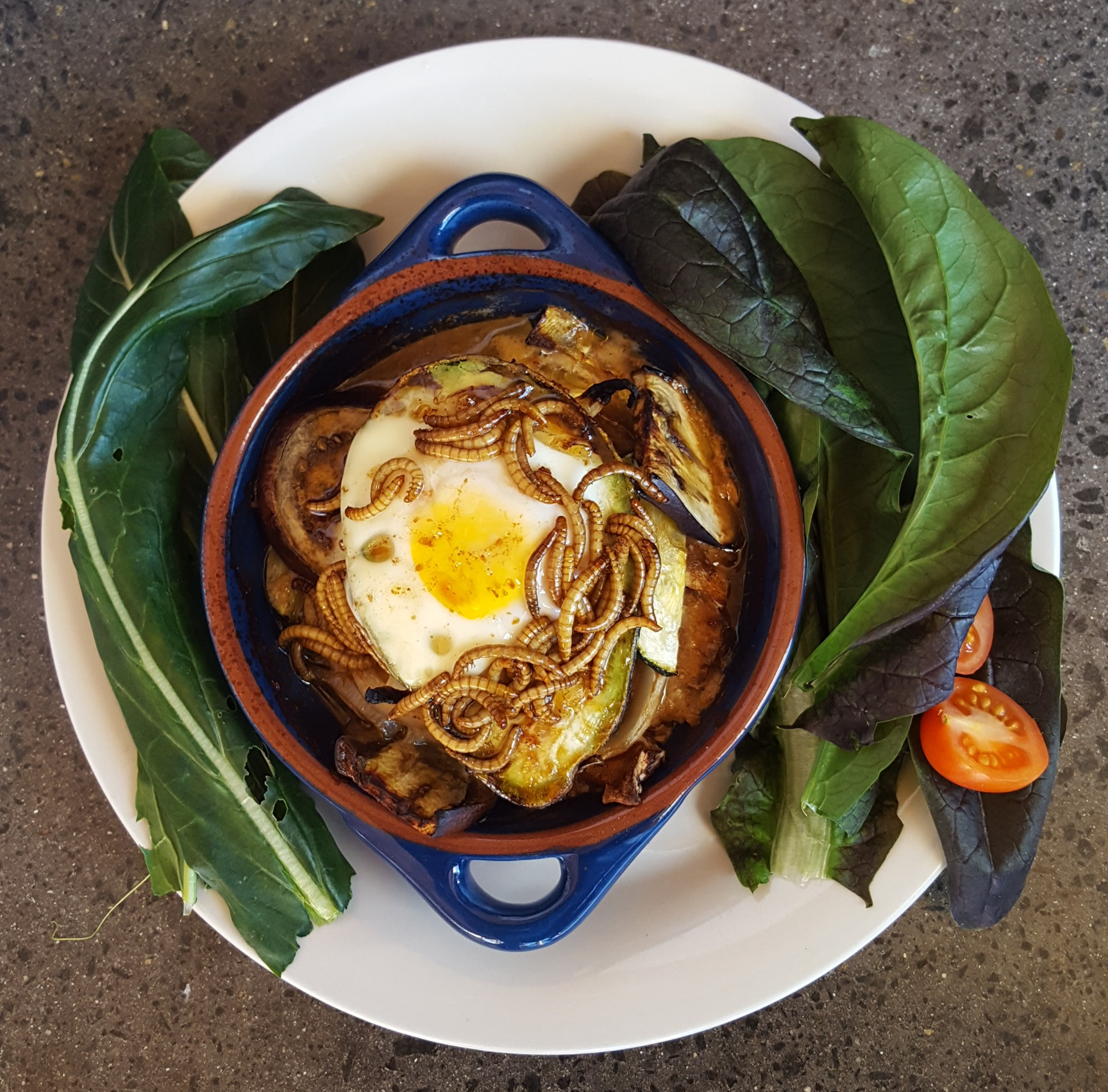 Baked avocado, egg and miso mealworm