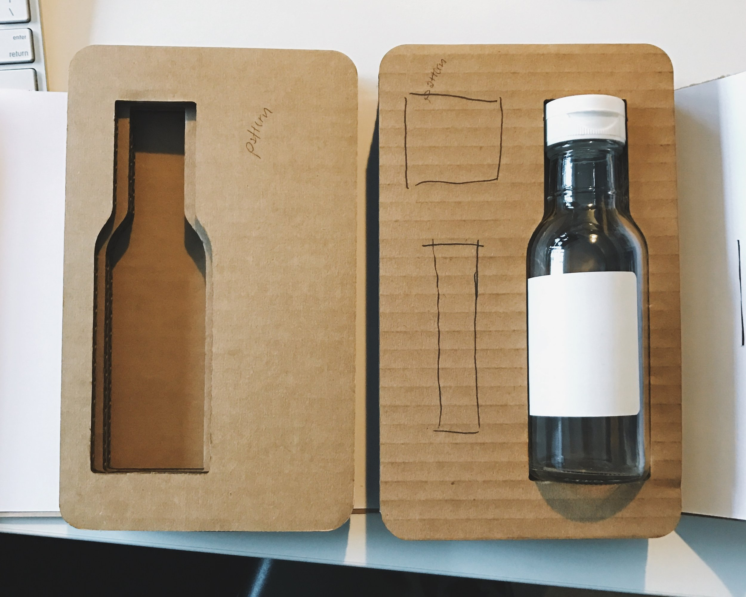 Early prototyping for the gift packaging for the 3 items done in-house with our laser cutter.