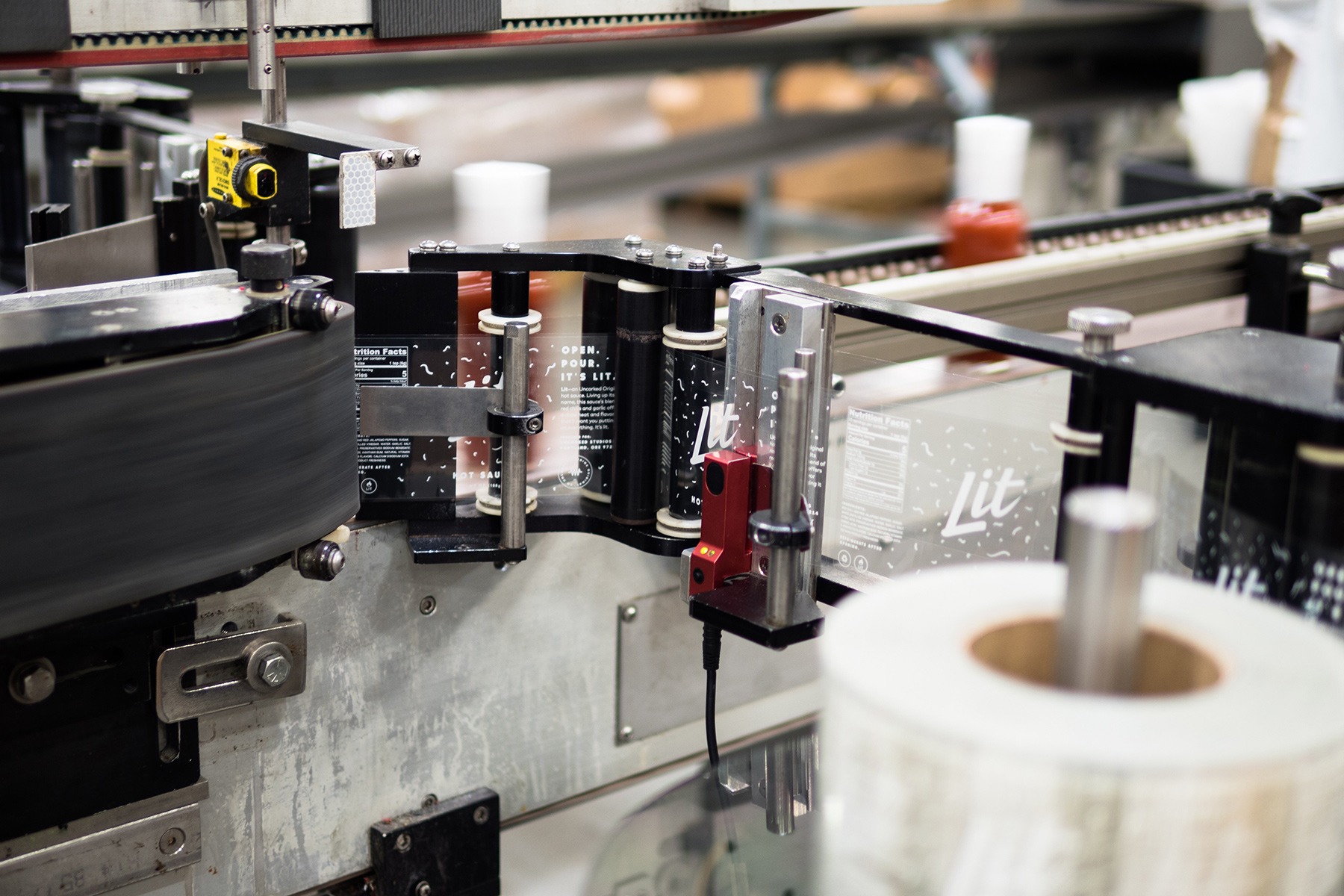 Bottle production for our Lit sauce at Beaverton Foods (Photo Credit: Matthew Noe).