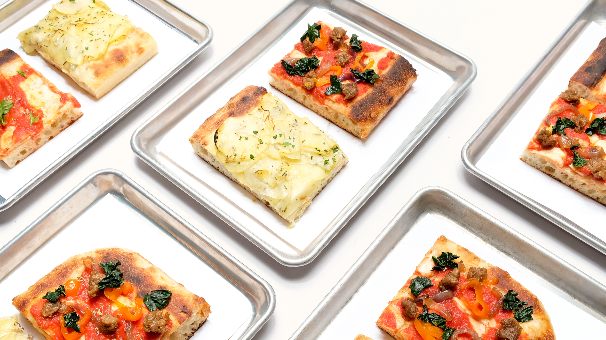 YA wants to own the square—not only through the way their pizzas looked, but what it was served on, as well as the logos and marks.