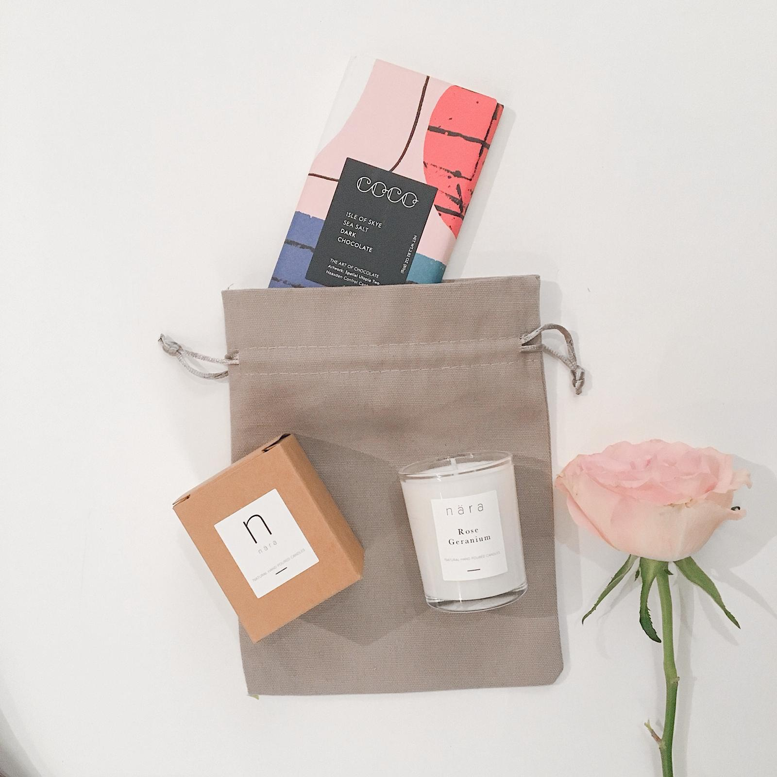 Just Because £13.50 - Sweet and thoughtful, this gift is bound to make your Valentine smile with a Rose Geranium votive candle, with a botanical scent reminiscent of a spa day and vegan COCO Chocolatier Isle of Skye Salt chocolate, presented in a keepsake pouch.