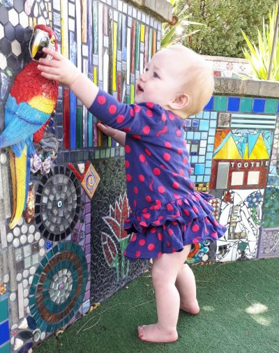 Toddler touching mosaics at Tootsie Fine Art and Design