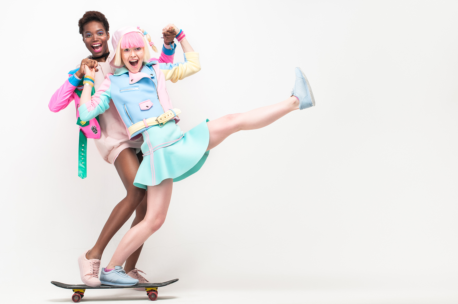From left to right: Jacket: #LenaGolova Hoody: Monki Skirt: #LenaGolova Choker: Diva Pink sneakers: H&M Jacket: #LenaGolova Hoody: H&M Skirt: #LenaGolova Choker: Accessorize and #LenaGolova Baseball cap: #LenaGolova Socks: Nike Blue sneakers: H&M
